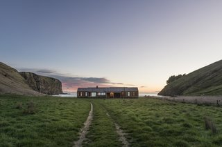 Accessible via helicopter or a 40-minute 4x4 ride overtop clifftop farm tracks, Scrubby Bay offers a remote slice of paradise on a working coastal farm.
