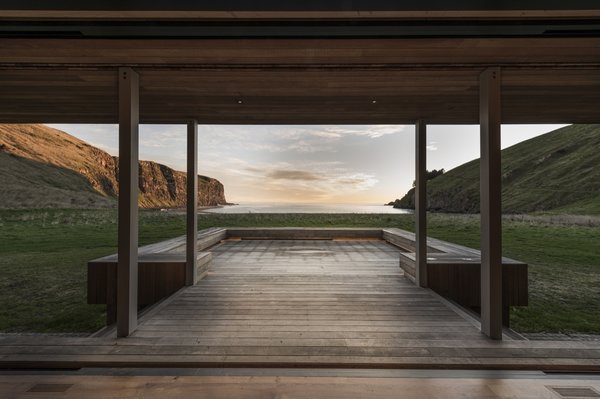 Sliding pocket doors create a seamless connection between the indoor living areas and the north-facing deck.