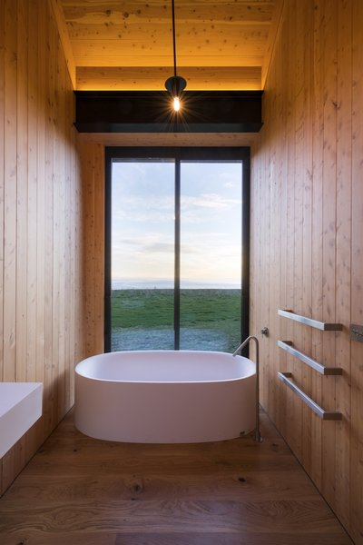 All three bedroom suites come with a soaking tub overlooking ocean views.