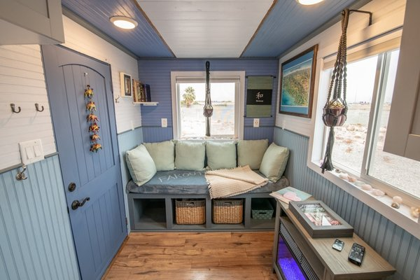 Formerly lined in unfinished wood panels, the tiny house now has new paint, finishes, and upgraded cabinets.