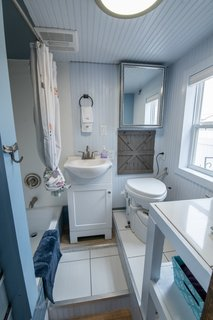 The compact bathroom includes a Nature's Head Compost Toilet. A high-powered exhaust fan, which Jilan considers a must-have for such a tiny house, helps eliminates bathroom smells.