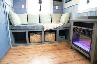 An electric fireplace heater from Walmart adds a touch of coziness and warmth to the living area.