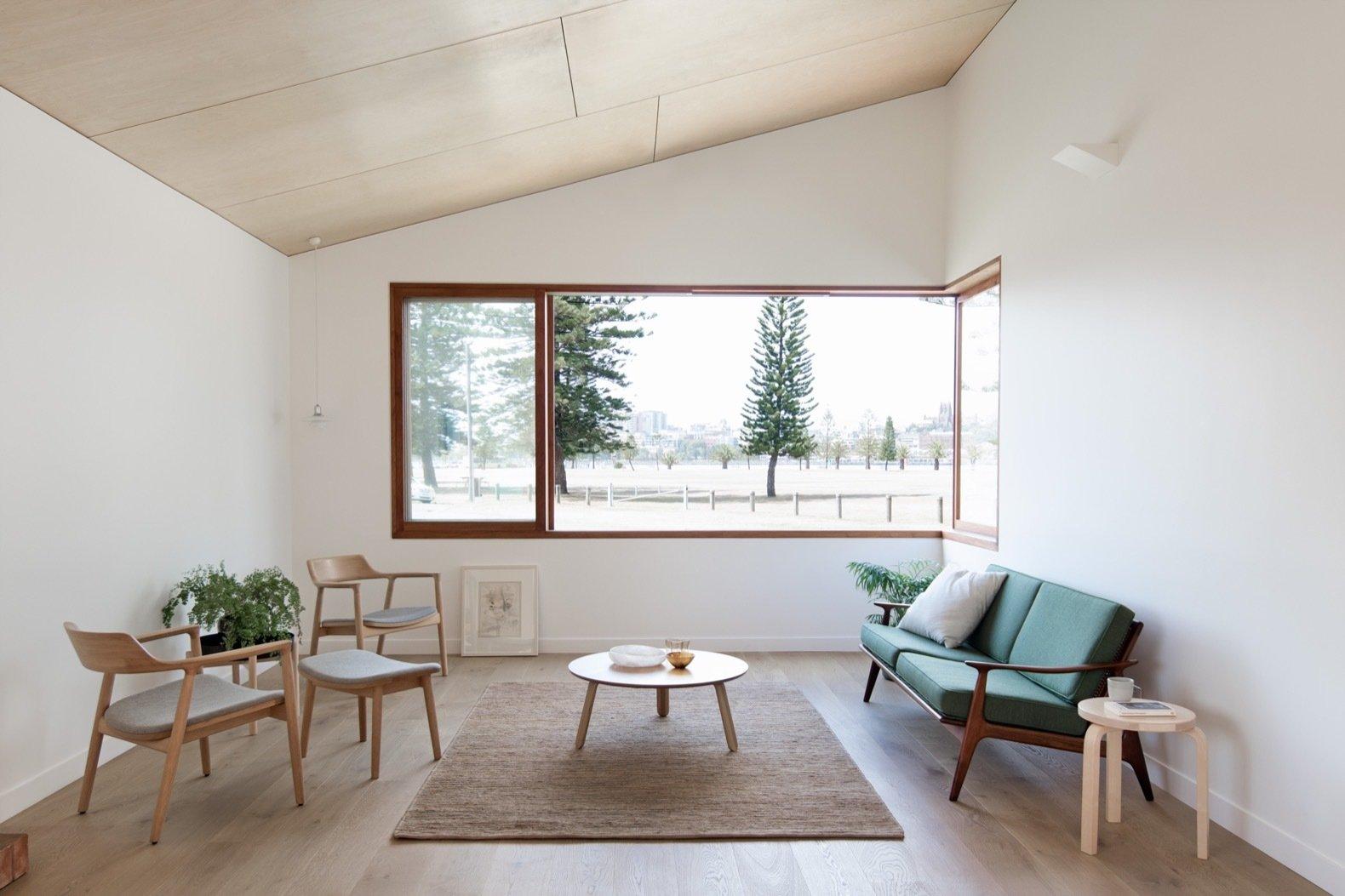 Three Piece House living room with corner window