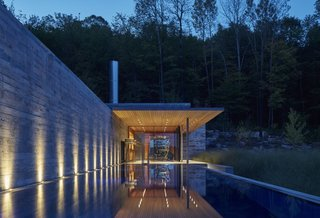 The Pool House seen at night.