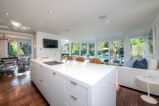 The kitchen with a center island is flanked by the dining room and sitting room.