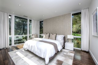 Elevated into the canopy, the master bedroom has a treehouse feel.