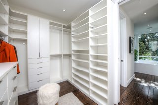 A peek into the walk-in closet next to the master bath.