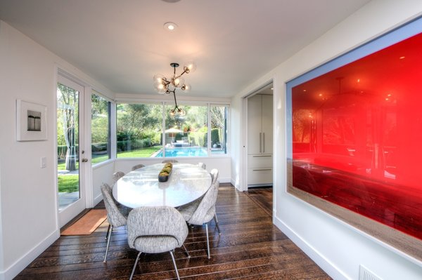 The dining room overlooks the pool.