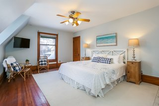 The large master bedroom comes with a luxurious master bath, three closets, and two large windows.