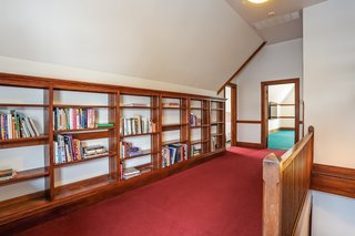The third-floor landing comes with built-in bookcases and a large additional storage closet.