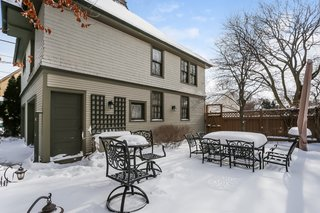 The remodel turned the two-story coach house into a garage with space for two large SUVs and plenty of storage.
