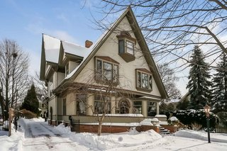 Punctuated with dormers of various sizes and sharply pitched roofs, this eye-catching home is a landmark in the La Grange neighborhood.