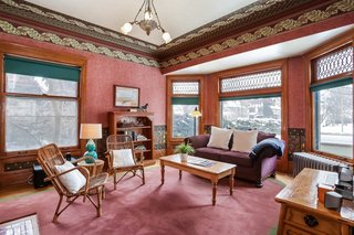 The family room includes a large bay window with original leaded glass and original hardwood floors.