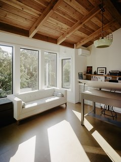 The sun-soaked art studio is elevated into the tree canopy.