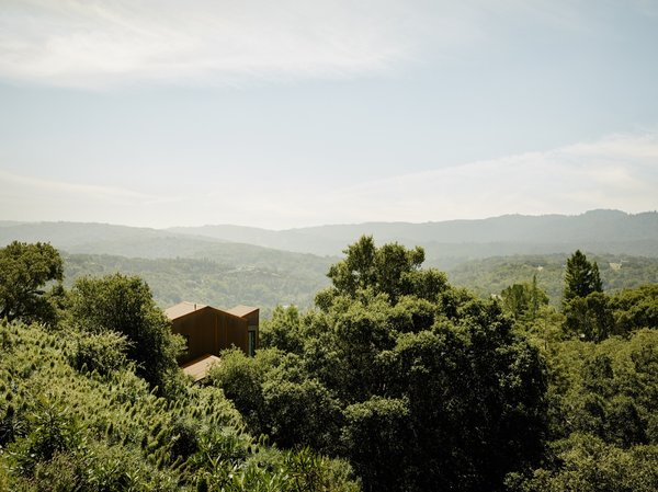 Set on a forested hillside, the home feels completely secluded. The closest neighboring house is 500 feet away and out of sight.