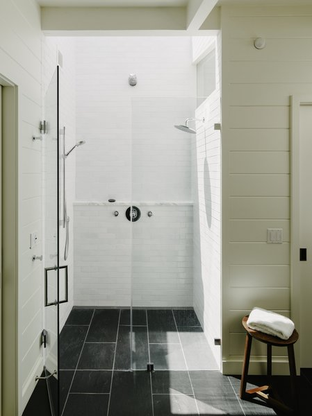 White Ceramic Fireclay Tile Wraps Around The Shower Skylights Bathe Master Bath In Natural