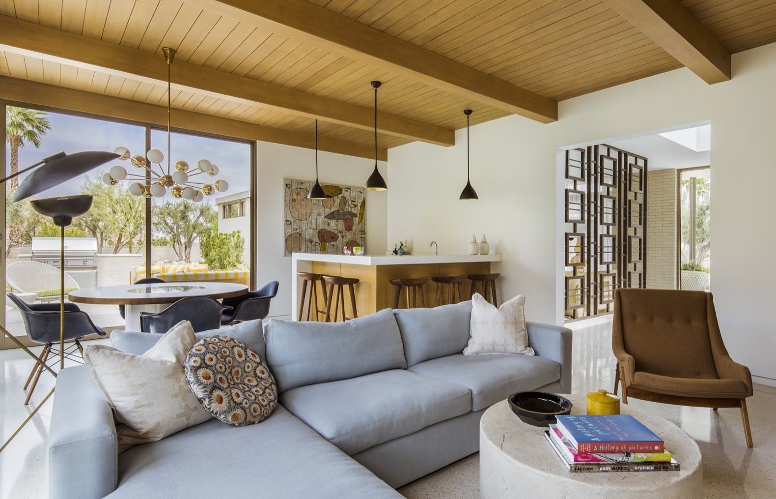 Living Room, Pendant Lighting, Chair, Coffee Tables, Terrazzo Floor, Sectional, and Recessed Lighting The home's terrazzo floors, fabricated by Architectural Concrete Innovations, are flecked with gold and brown accents.