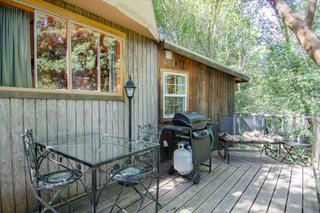 Guests can enjoy a meal out on the deck, which comes with seating, a table, a barbecue grill, and an extra gas burner.