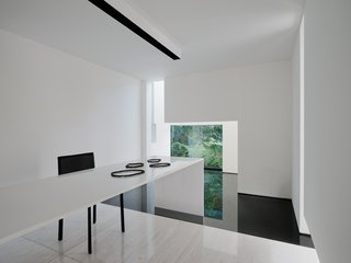 The architects designed the marble table. The chairs are by Montis and Magis.