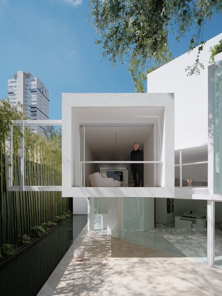 Miguel Angel Aragonés is seen in the cantilevered second-floor bedroom that overlooks the rear courtyard.