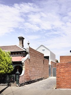 Located in North Fitzroy, the 2,272-square-foot Grant House is set on a long and narrow east-facing site with shared side alley access.