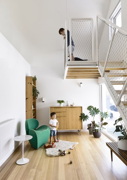 """On the other side of the bathroom """"box"""" is a lounge with a lofted reading room. The space also serves as the perfect play room."""