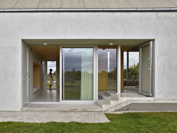 Every room can be directly accessed from the garden. The house has six entrances in total.