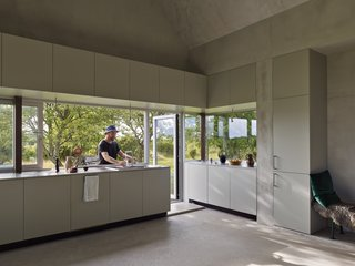 In the summer, the kitchen counter transforms into an indoor/outdoor kitchen island. The outdoor dining room is located between two whitebeam trees.