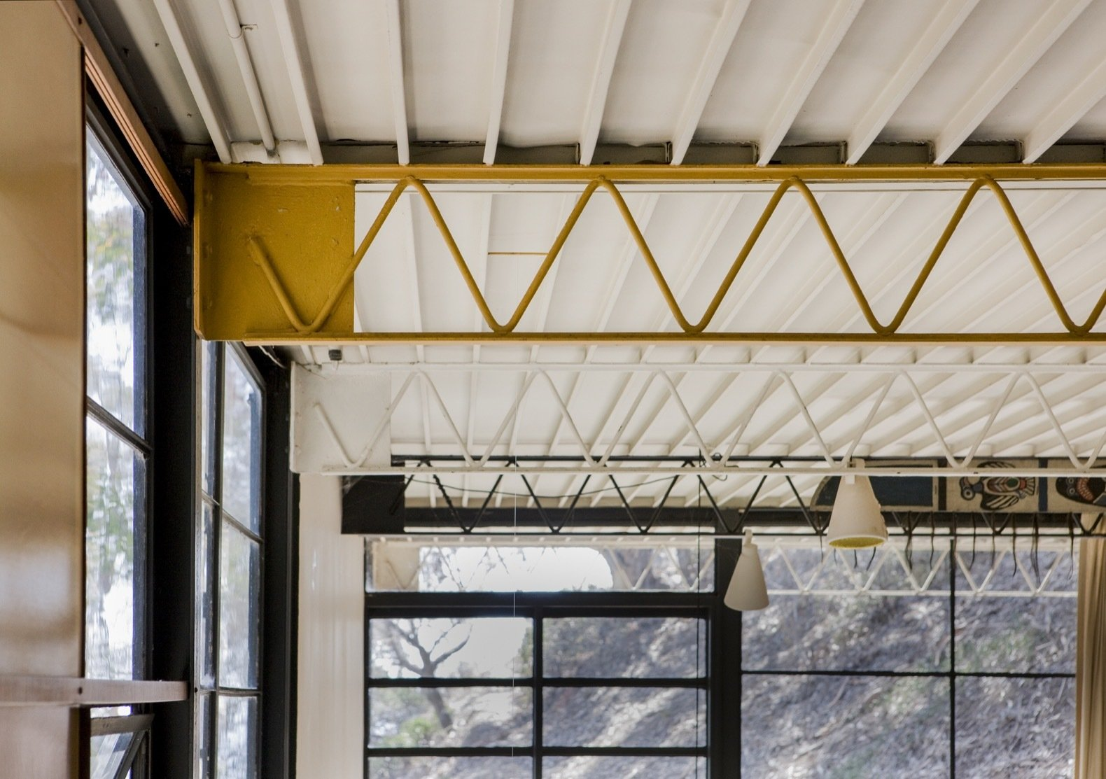 The exposed web joists were painted different colors while the ribbed underside ceiling of the Ferrobord roof decking was painted white.   Photo 20 of 21 in Getty Unveils New Plan to Conserve the Iconic Eames House