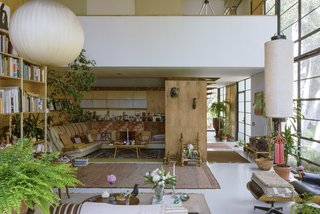 A view of the living room, looking north. The overhanging balcony belongs to the bedroom area.
