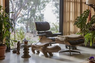 A newly replaced Eames Lounge Chair and Ottoman sit in the living room.