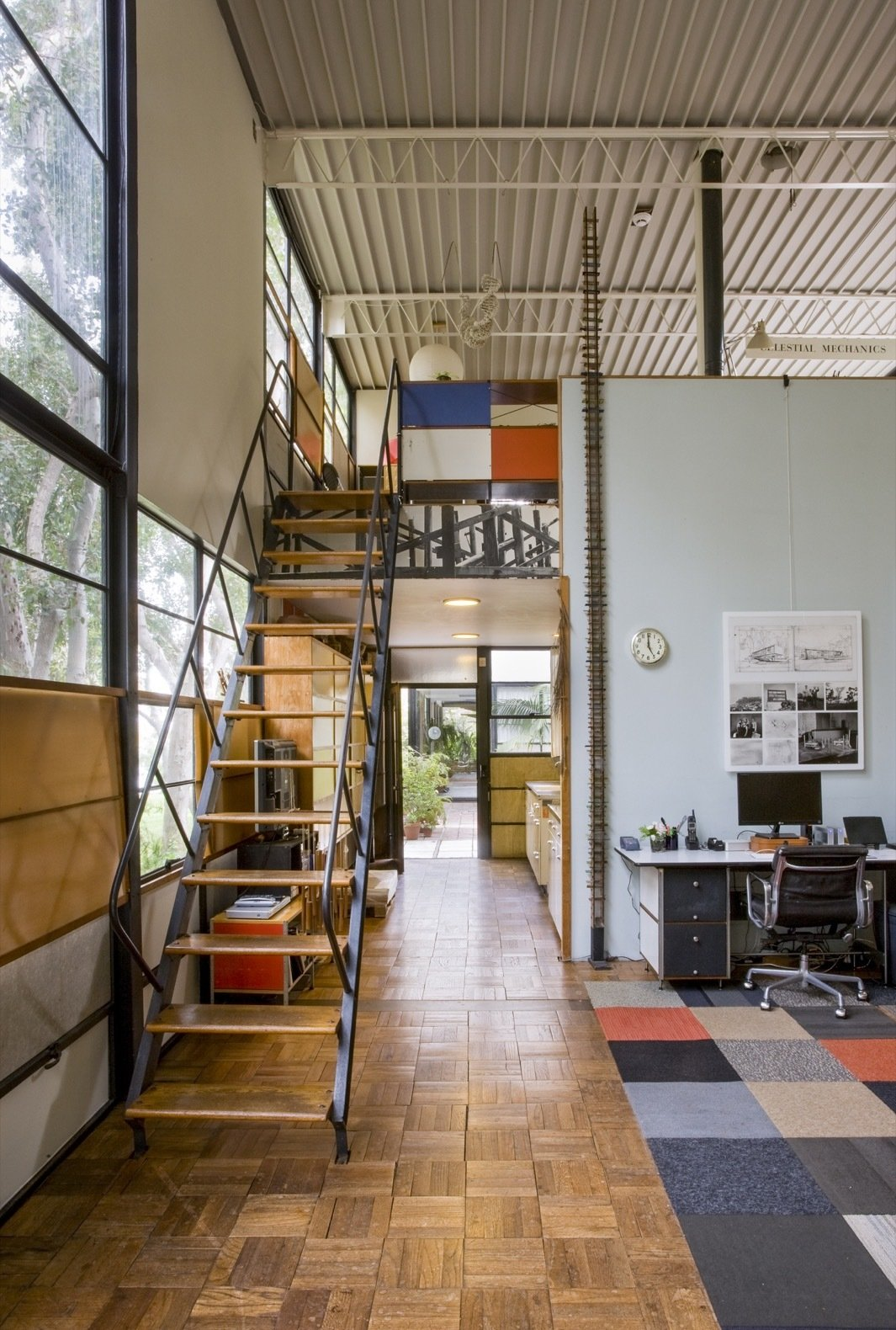 The double-height spaces gives the home greater flexibility and a sense of airiness.   Photo 19 of 21 in Getty Unveils New Plan to Conserve the Iconic Eames House