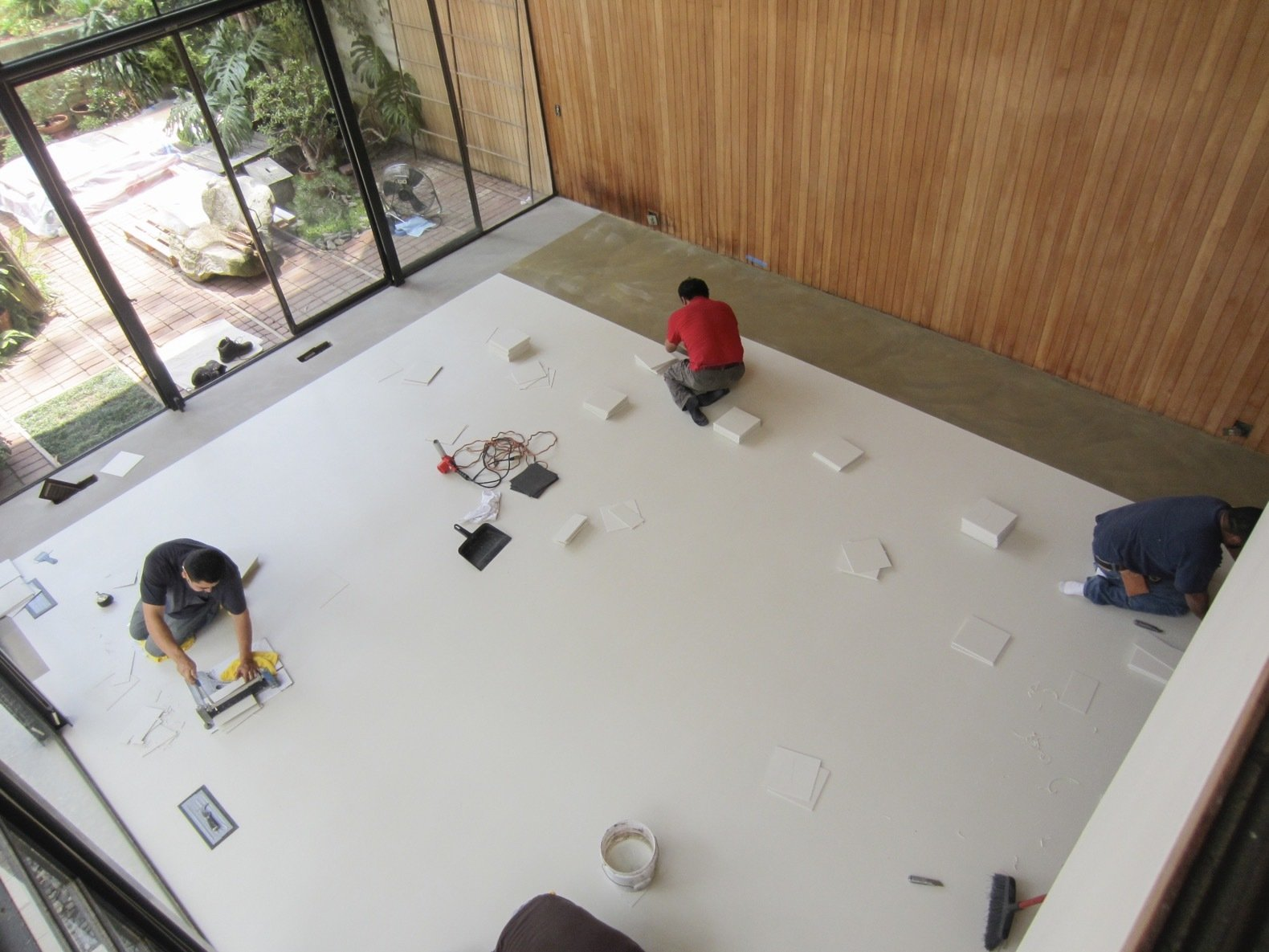 As part of the CMP process, the severely damaged square vinyl-asbestos tiles in the living room were and replaced with vinyl-composite tile flooring.   Photo 9 of 21 in Getty Unveils New Plan to Conserve the Iconic Eames House