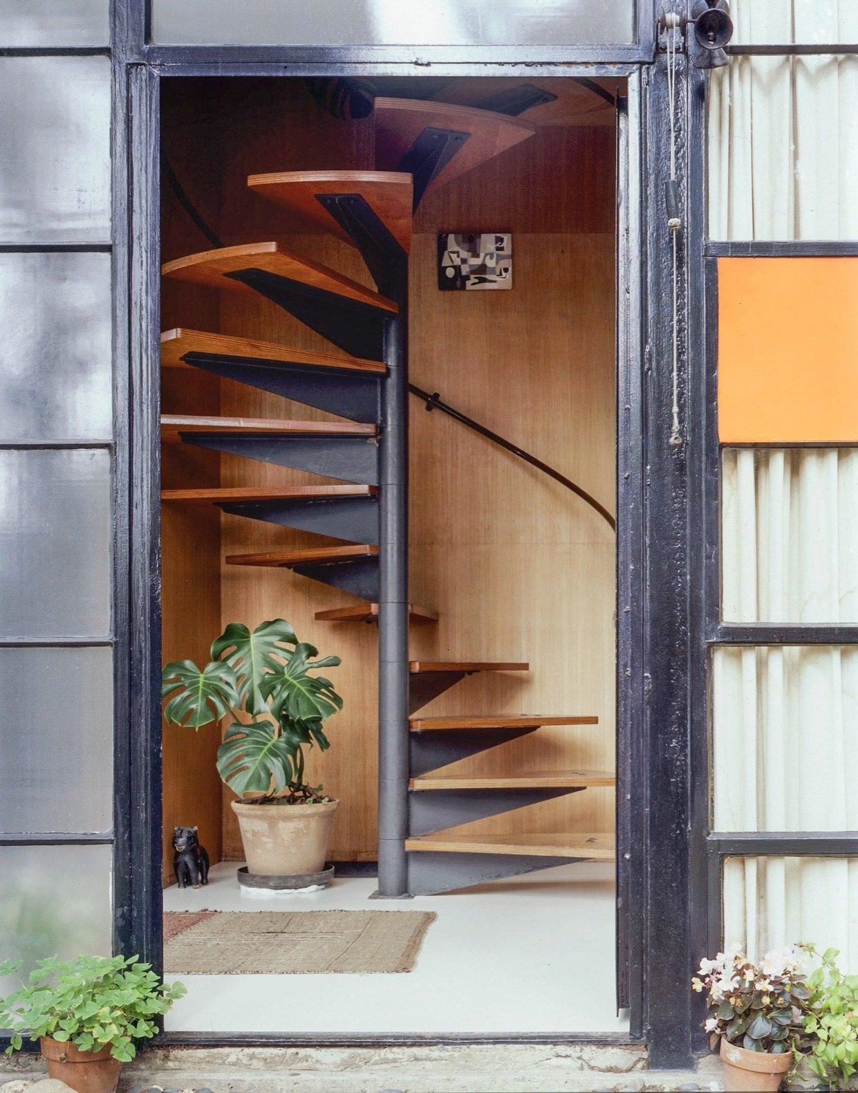 Illuminated by a skylight, the spiral staircase ascends to the bedroom level.  Photo 18 of 21 in Getty Unveils New Plan to Conserve the Iconic Eames House