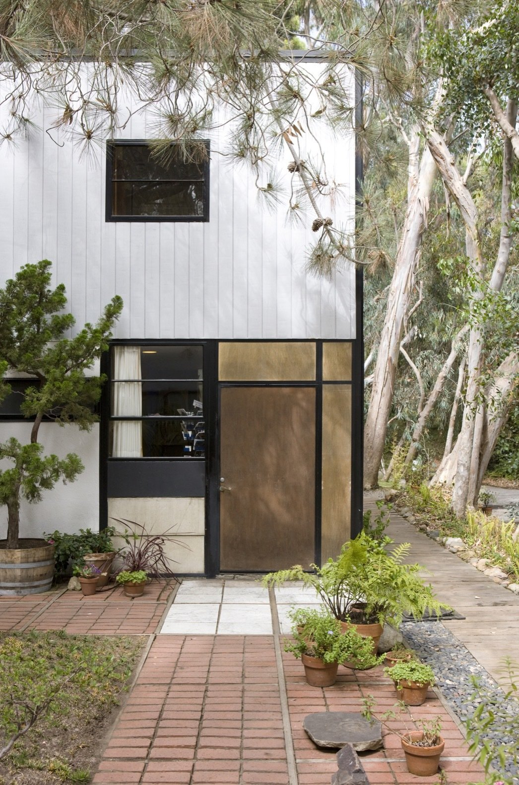 "The south elevation of the studio. Note the variety of materials used; Ray and Charles used a mix of panels that included plaster, plywood, asbestos, glass, and fiberglass-like ""pylon"".  Photo 7 of 21 in Getty Unveils New Plan to Conserve the Iconic Eames House"