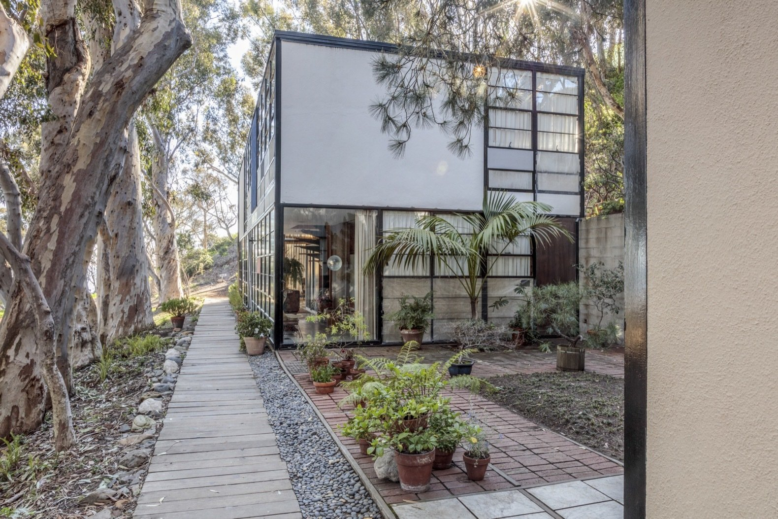 A view of the central court with brick, marble, and wooden pavers laid out in a grid pattern.   Photo 14 of 21 in Getty Unveils New Plan to Conserve the Iconic Eames House