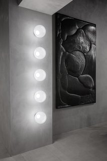 In addition to serving as a restaurant and showroom, The Manzoni can also be used as an art gallery or nightclub. The wall features Tom Dixon's new semitranslucent Opal lights, which are made from tinted white opalescent polycarbonate and include an integrated dimmable custom LED.