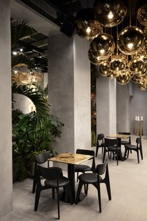 The restaurant pairs new Slab chairs with stone tables by Testi.
