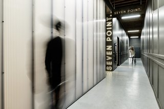 To make the long corridor more inviting, polycarbonate walls were installed to brighten up the space while preserving a sense of privacy.