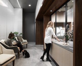 The space is defined by white oak, glass, polycarbonate walls and bronze accents.