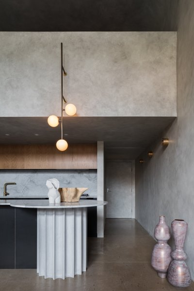 Above the granite counter, a custom light by Volker Haug provides a pop of contrast.