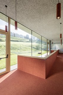 Colorful FINDEISEN needled carpets cover the floors, walls, doors—and even the lighting.