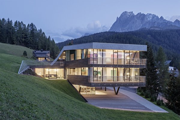 Set on a steep slope, the building features angled geometry that mimics the mountains and terrain.