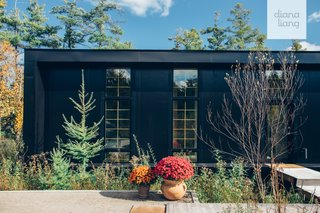 Located in northern Michigan, the two-bedroom Lake House is built of metal structural insulated panels and channels Scandinavian design influences.