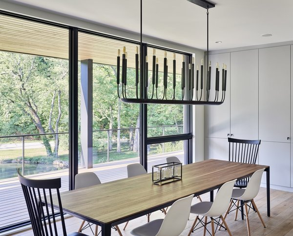 A Restoration Hardware Modern chandelier hangs above the dining table designed by Hufft.