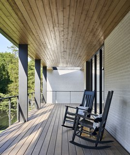 A pair of rocking chairs are perfectly positioned for taking in views of the stream.