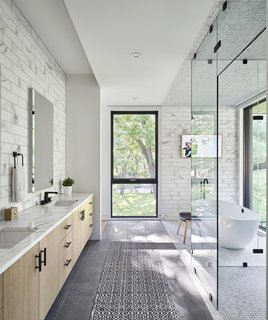A peek inside the light-dappled master bath.
