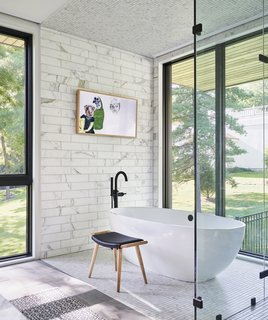 The Victoria + Albert Barcelona tub overlooks views of the outdoors.
