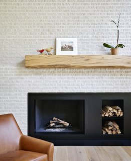 The fireplace mantel was crafted from an oak tree felled on the property.