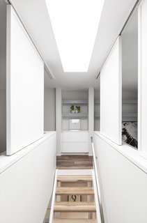 Open-tread, two-inch, hickory butcher block stairs allow natural light to penetrate deep inside the home.